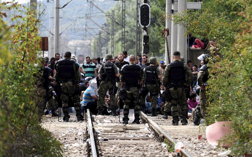 Macedonian special policemen guard the border as more than a thousand immigrants wait at the border line of Macedonia and Greece to enter Macedonia near the Gevgelija railway station